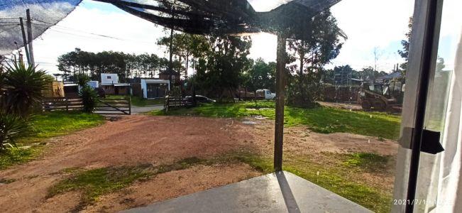 terreno en zona de La Fortuna con construccion,todo regularizado